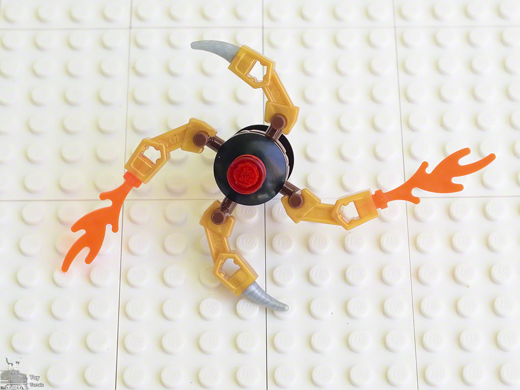 Simple LEGO spinner flame star shows a small 4 arm LEGO spinner with alternating flame and horn pieces at the end of the arms