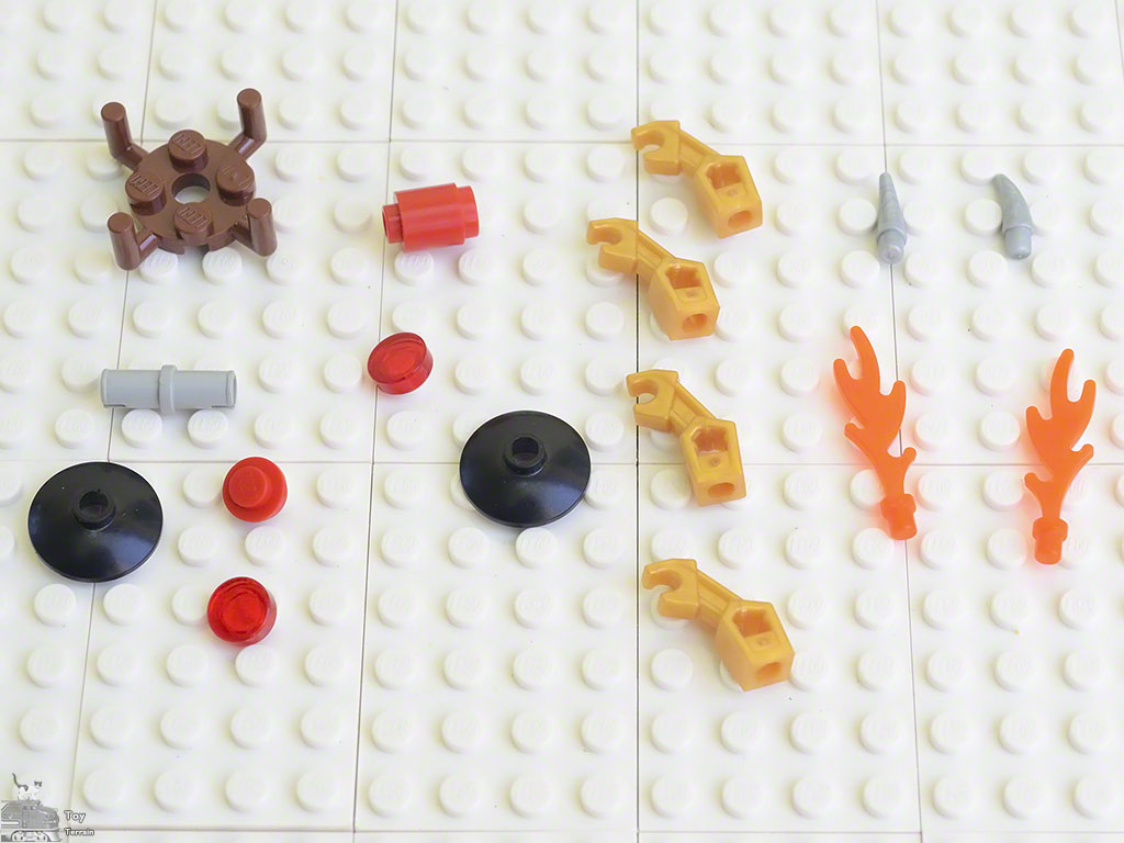 LEGO pieces used to make the flame star spinner laid out on a LEGO plate