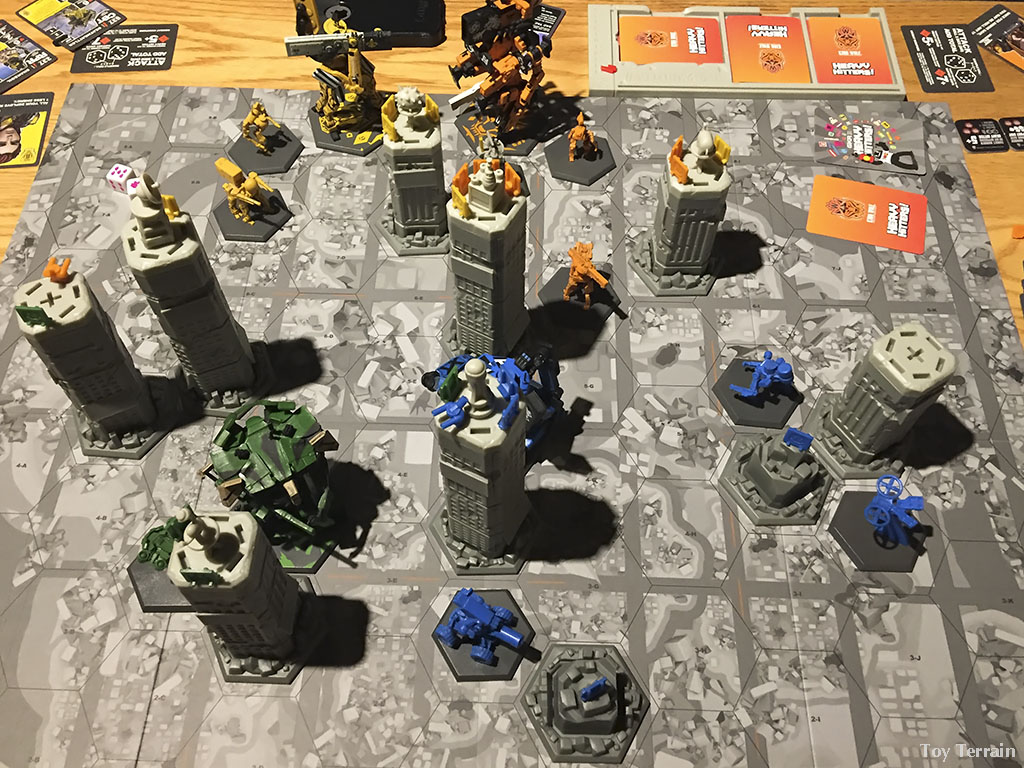 GKR Heavy Hitters game board with robots and buildings