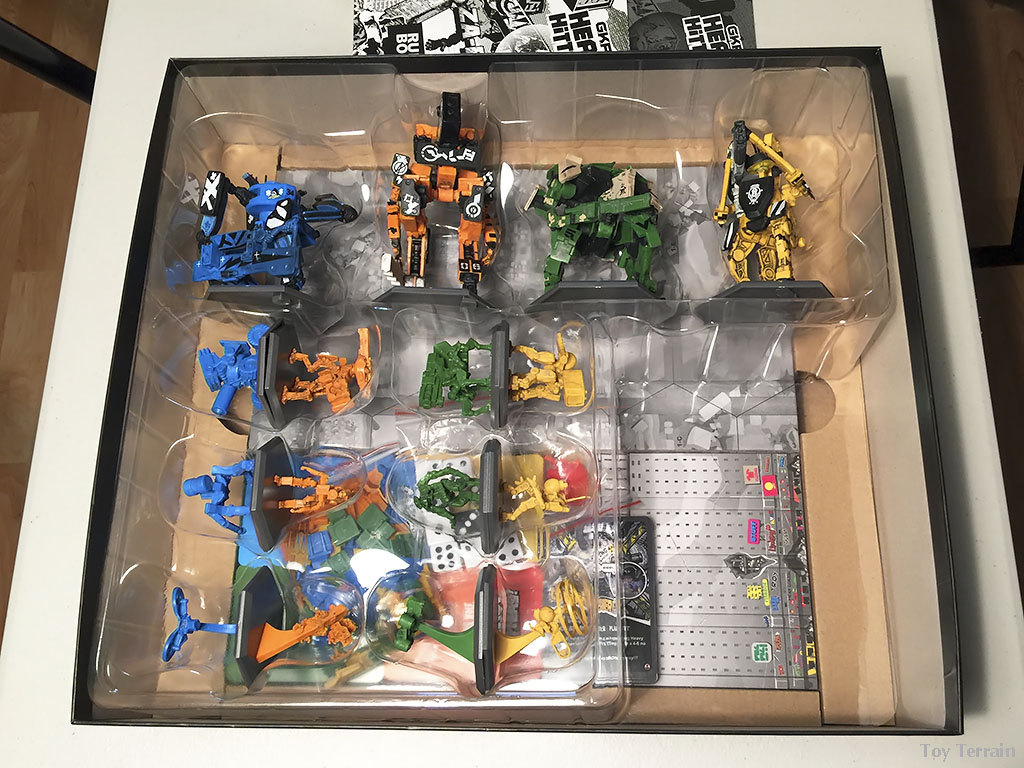 GKR Heavy Hitters Unboxing - view of the robots in the plastic form with game board visible in the bottom of the box