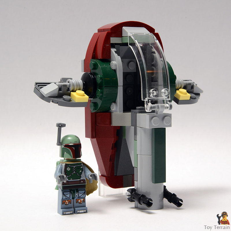 Boba Fett minifigure stands beside a LEGO Star Wars Slave 1 MOC microfighter