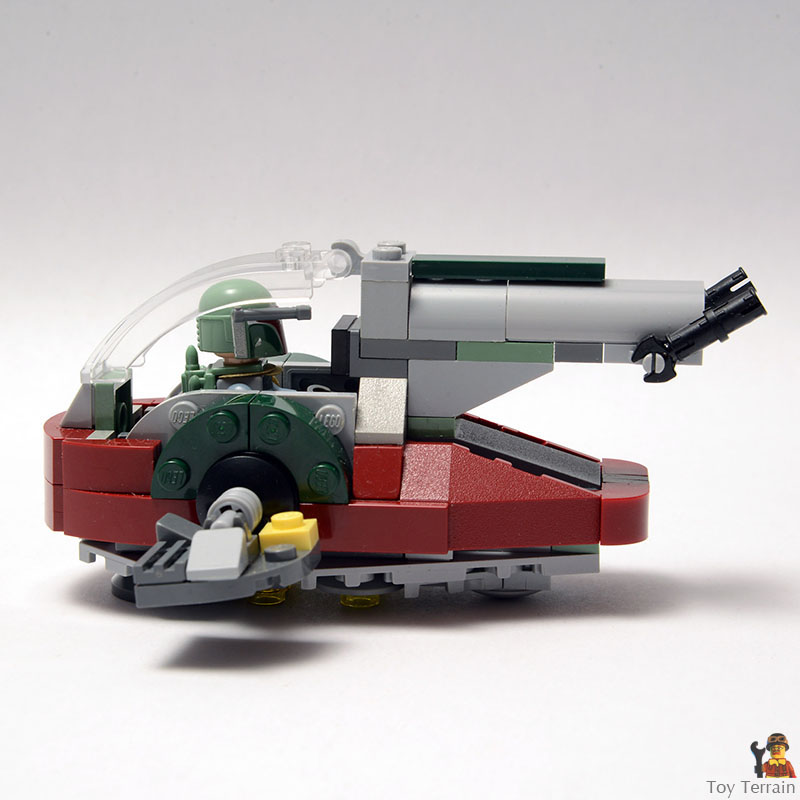 SIde view of Boba Fett seated in the cockpit of the LEGO Slave 1 MOC microfighter